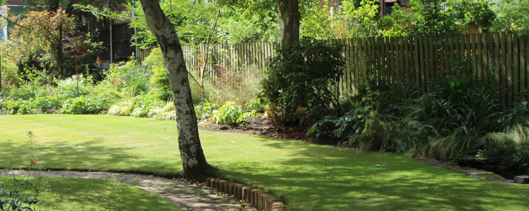 Make your garden look wider by making sure the centre of the garden is clear, sweeping the borders to the side and using circular or oval shapes