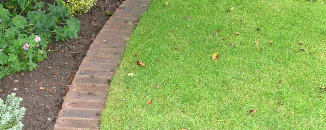 Make your lawn easier to maintain with brick edging